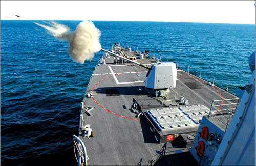 Fig-19: US Combat Naval Vessel 'USS Forest Sherman' fires its gun (Photograph courtesy: US Navy, through Wikipedia)