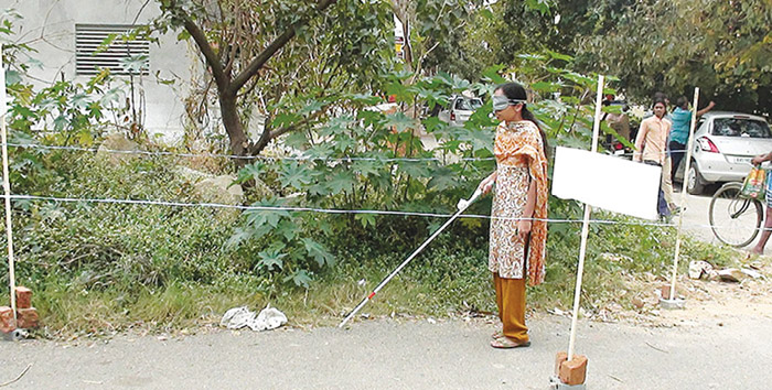 A woman using SmartCane