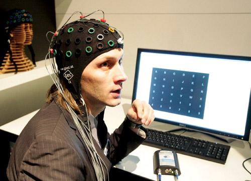 A researcher sporting brain-computer interface headgear(Courtesy: www.oxbridgebiotech.com)