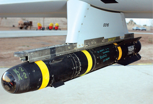 Fig. 5: American AGM-114 Hellfire laser-guided missile on predator drone. Missile's front tip is the eye (Photograph credit: US Department of Defense, through Wikipedia)