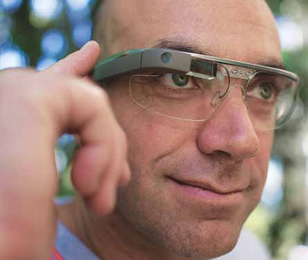 A man controls Google Glass using the touchpad built into the side of the device (Courtesy: Wikipedia)