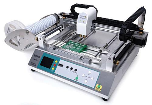Fig. 3: A desktop SMT pick-and-place machine