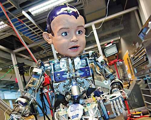 Diego-san, a boy-like humanoid teaching robot being developed at the University of California, San Diego (Courtesy: University of California, San Diego)
