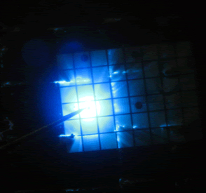 Figure2. Magnified view showing blue-emitting gallium nitride LEDs on a section of LED wafer being tested for proper operation.