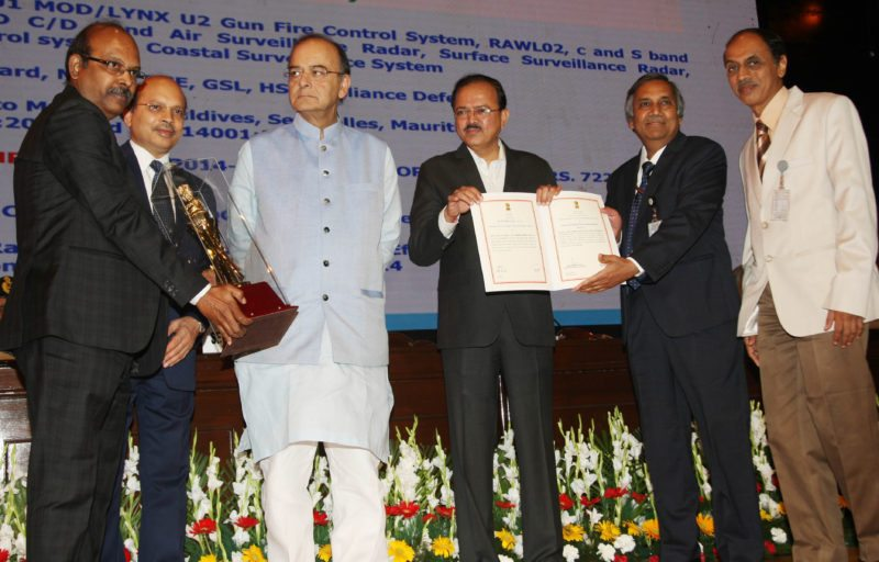 "Mr M V Gowtama, Chairman & Managing Director, BEL, and Mr Girish Kumar, Director (Bangalore Complex), BEL, receiving from Mr Arun Jaitley, Raksha Mantri, the Raksha Mantri's Best Performing Division/Factory/Shipyard Award for the ""Best Performing Division"" among DPSUs for Naval Systems II SBU, BEL-Bangalore, for the year 2015-16."