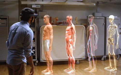 An AR headset enables anatomy students to examine a virtual human body and navigate through successive layers of skin, muscle and organs.