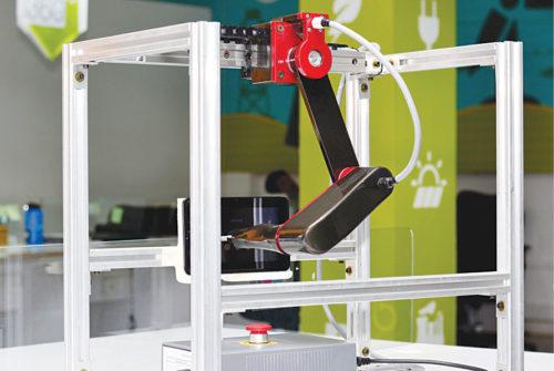 Robot testing a smartphone (Credit: www.sastrarobotics.com)