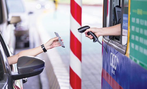 Smartphone being used to pay highway toll via an online payment service app