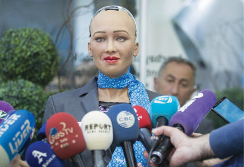 Sophia, an AI-powered humanoid robot, meeting journalists
