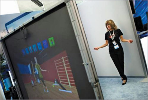 A lady in front of Intel Magic Mirror (Credit: http://newsroom.intel.com)