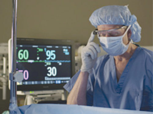 An anaesthesiologist keeps his attention on the patient while viewing vital signs via Google Glass (Credit: www.medical.philips.com)