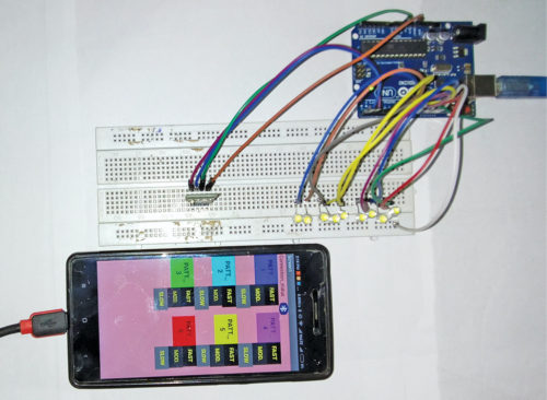 Authors' prototype wired on breadboard along with smartphone for Control Light Animations