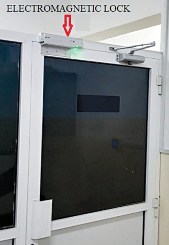 Electromagnetic lock installation on a glass door