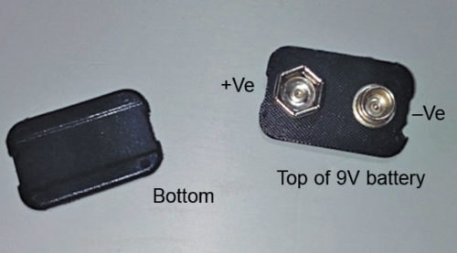 Top and bottom portions of battery