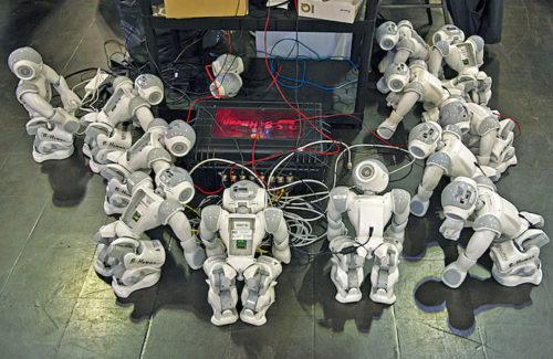 Robots at a battery charging station (Credit: www.theatlantic.com)