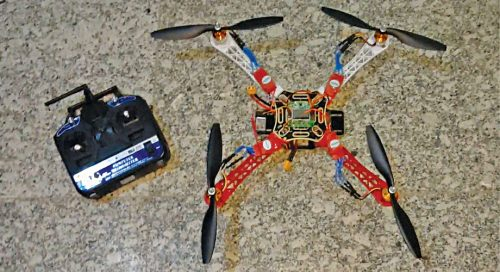 Quadcopter drone with ESC module mounted on each arm
